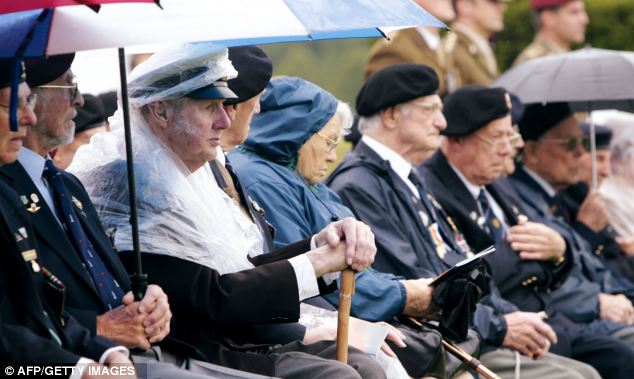 Resistance: British veterans gathering in Normandy for the annual D-Day memorial are among those opposed to plans to erect a wind farm offshore from the landings site